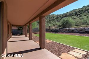 Large covered patio area, wide and deep lot backs to mountain; pool sized lot; more than 22,000 sqft lot