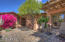 Beautiful courtyard bougainvilla and French doors to dining room.
