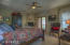 Master bedroom has fireplace and French doors to back yard and additional exit to side patio.