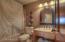 Full guest bath adjoins the den.