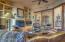Beautiful wood vigas frame the living area.