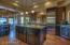 Kitchen has window pass-through to family room.
