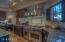 Gourmet style kitchen with Wolf gas range.
