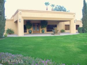 Great Curb Appeal with Pavered Circular Driveway and Large Porte Cochere.