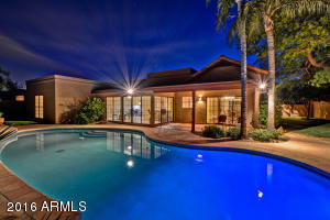 beautiful pool in evening light, well lit home and patios large side yard with grass and citrus, grass play area and large private courtyard