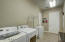 Huge laundry room with large storage closet. ( 5 large storage closets throughout home!)