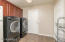 You will love this: Large Laundry Room with direct access to your 3 Car Garage. W/D and second refrigerator all convey to the buyer! Wonderful Walk-in Pantry also is located in the Laundry Rm, seen to right of this photo.