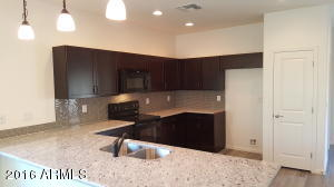 Granite Counter tops, back splash, and Oiled Rubbed Bronze fixtures