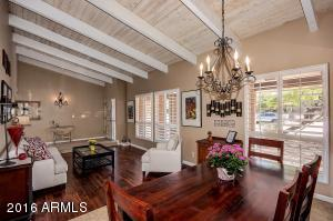 Light bright living/dining room with plantation shutters.