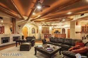 Great room is 25' x 30', has solid oak flooring, vegas, French doors to patio and banco seating.
