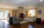 The family room is surrounded by lots of light via a window & 2 sets of French doors.