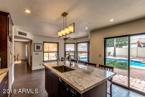You can view the backyard and pool from anywhere in this kitchen!