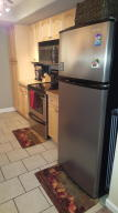 Beautiful remodeled kitchen with stainless steel appliances and granite countertops.