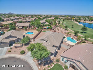 Oversized golf course lot with heated pool, spa, fire pit, BBQ island, and synthetic grass!