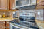 Stainless Steel appliances, Granite Counters and Travertine backsplash