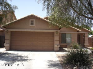 Well maintained exterior with mature trees and shade.