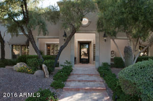 Beautiful Entry with Iron Door. North/South exposure on a 14,900 sq ft lot.