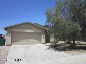 Low maintenance front yard with a huge shade tree!