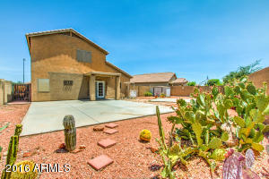 Huge backyard with covered patio, beautiful, low maintenance desert landscaping.