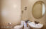 """Powder Room next to den, part of guest suite potential conversion. Currently measures 4'9"""" x 6'5"""""""