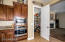 """Stainless wall oven and walk-in pantry. Pantry measures 5'5"""" x 6'1"""""""