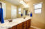 "Bath two with dual vanities separates bedrooms in East Wing. Measures 11' x 7'3"""