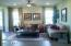 """Large formal living room waiting for your influence. Measures 16'7"""" x 19'6"""". This is a staged photo of the formal living room to lend perspective."""