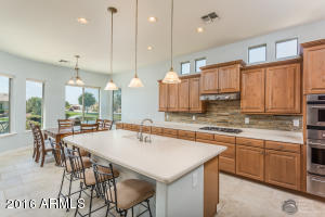 Features Staggered Maple Cabinets, Stainless Steel Appliances, and Corian Countertops