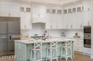 Special interior lighting highlights the custom built hardwood cabinetry