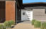 Custom front door with custom steel in carport