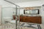 """Master Bath with glass shower enclosure and 36"""" high vanity"""