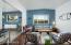 Sunken living room with hand scraped wood floors