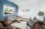Sunken living room has large window with views to backyard