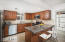 Kitchen features newer stainless steel appliances with window facing carport