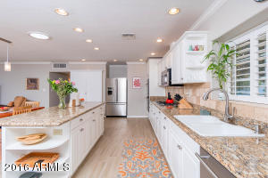 Wall to wall counters with large island looking out to great room