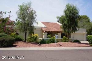 This home is an unbeatable location in McCormick Ranch- only 1 door off the greenbelt!