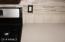 NEW Quartz Countertops with Travertine and Glass Backsplash