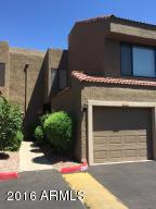 Front of townhome with pleasant landscaped walkway.
