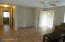 Great Room with ceramic tile flooring, ceiling fan and media niche!