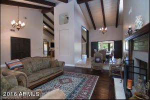 Formal living room with Fireplace opens to Formal Dining Room