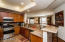 Enjoy cooking in the great kitchen with gas range, dishwasher, microwave, and refrigerator. Looks like a model