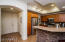 Beautiful open kitchen with granite counters and designer glass tile accents on the breakfast bar.