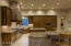Custom Alder cabinetry with exceptional and extensive storage spaces