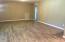...upgraded wood-look tile flooring