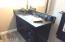 ...honed granite vanity top, designer mirror, upgraded sink and faucet