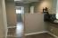 Open office area behind kitchen