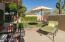 Grassy area that wraps around to front patio