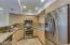 Stainless appliances and granite countertop / backsplash