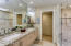Remodeled master bath has extra large walk-in shower, granite counters with double under-mount sinks, custom vanity and mirrored medicine cabinets