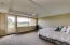 Spacious master bedroom with enlarged windows and new door letting in the light and the enhancing the view